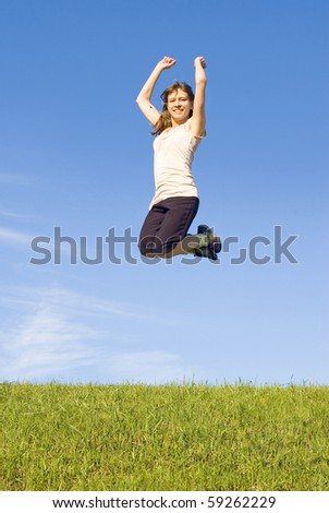 Girl in a jump in the blue sky