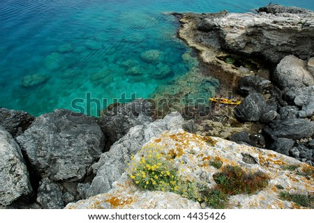 girl in a kayak at the tremiti islands