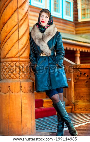 girl in a leather coat and painted scarf - stock photo