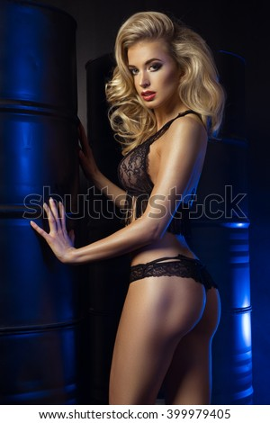 Girl in a lingerie in the interior with barrel  - stock photo