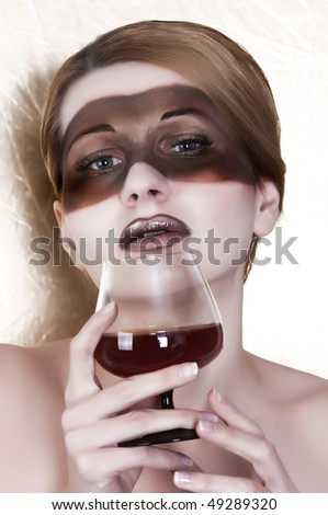 girl in a mask with a glass