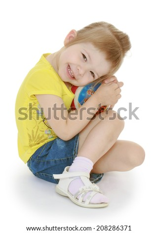 girl in a Montessori group plays with a ball on a white background.kindergarten, the concept of childhood and joy, teens