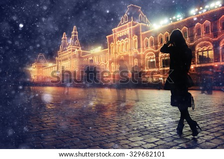 girl in a night city snowflake Christmas city lights - stock photo