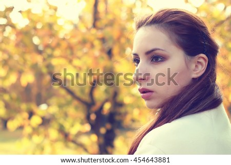 girl in a park walk autumn alone