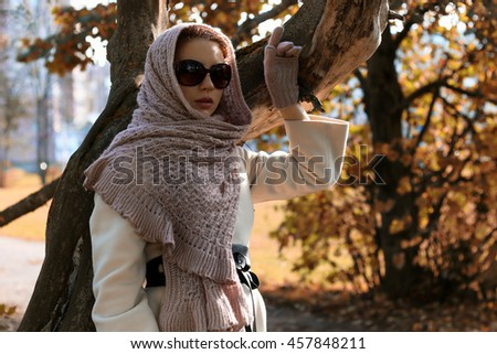 girl in a park wear a scarf autumn - stock photo