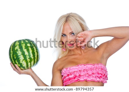 girl in a pink bikini, with a beautiful figure, holding a watermelon