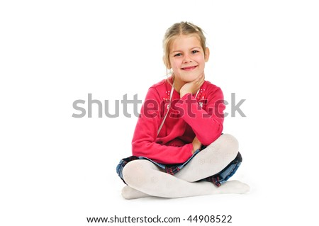 girl in a pink blouse, sits cross-legged