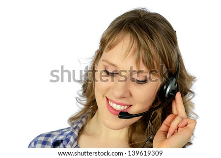 Girl in a plaid shirt talking on a headset. Isolated on white background. - stock photo