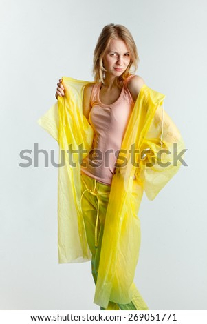 girl in a raincoat - stock photo