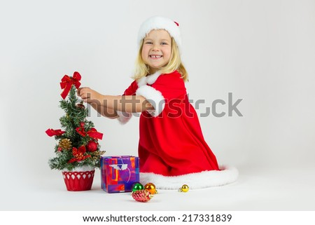 Girl in a red Christmas costume - stock photo