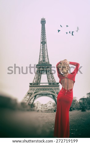 girl in a red dress on a background of the Eiffel Tower. In the style of instagram. vintage retro. - stock photo