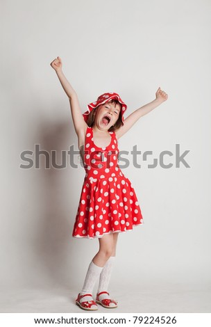 Girl in a red dress, wide yawning stretching - stock photo