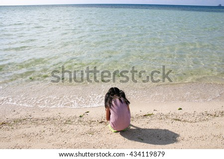 Girl in a sandy beach - stock photo