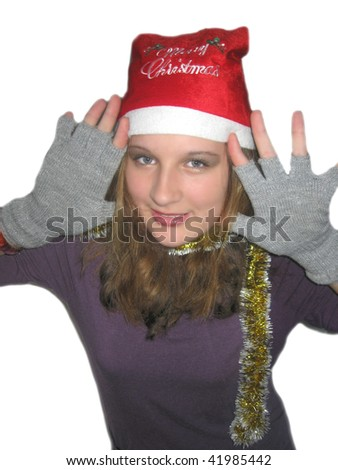 Girl in a Santa Claus hat, in anticipation of Christmas