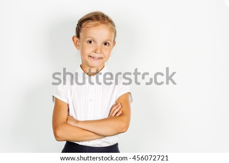 girl in a school uniform crossed arms near whiteboard. Learning and school concept. Image on white background. - stock photo