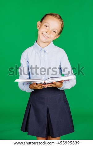 girl in a school uniform holding a book. Learning and school concept. Image on chromakey background. - stock photo