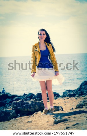 girl in a skirt near the sea - stock photo