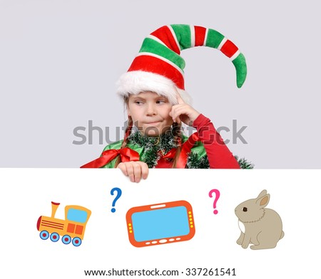 Girl in a suit of the Christmas elf thought of a gift. White banner with illustrations of toy, gadget and pet