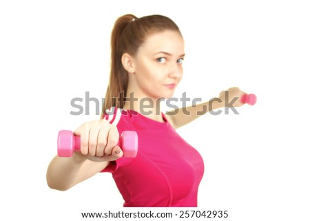 Girl in a tracksuit with dumbbells in hands isolated - stock photo