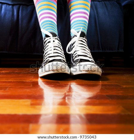 girl in a waiting room. Close up of her footwear - stock photo