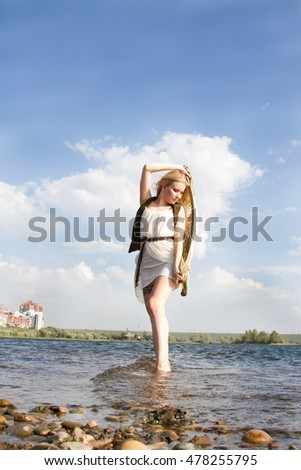 girl in a white dress on the shore