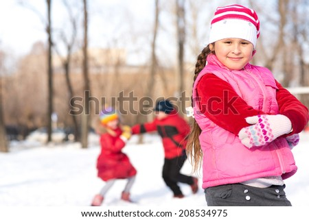 girl in a winter park, actively spending time in winter - stock photo