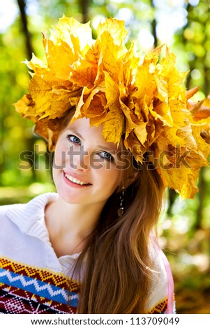 girl in a wreath from autumn yellow leaves
