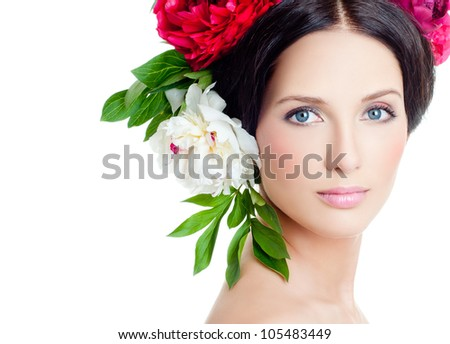 Girl in a wreath of flowers - stock photo