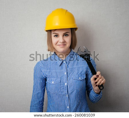 girl in a yellow helmet with a key - stock photo