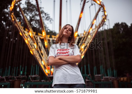 girl in amusement park at night