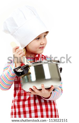 Girl in an apron and cook cap holding pan - stock photo