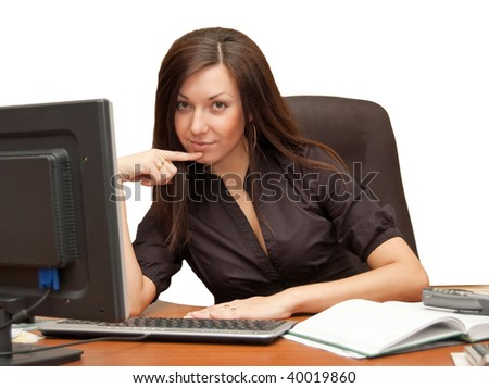 Girl in an armchair at the computer