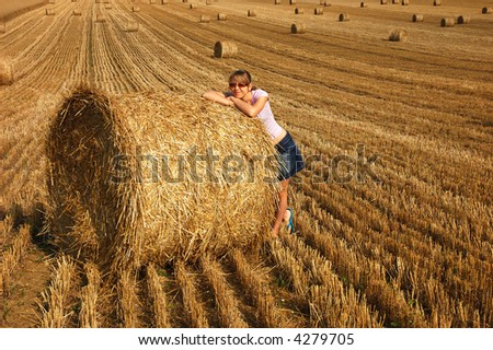 Girl in an autumnal field - stock photo