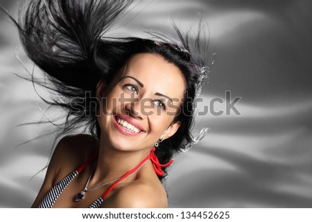 girl in an emotional flight with the wind from the developing hair