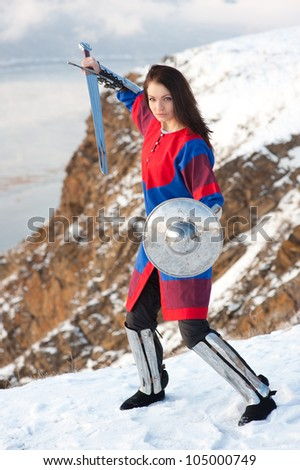 Girl in armor with a sword knight - stock photo