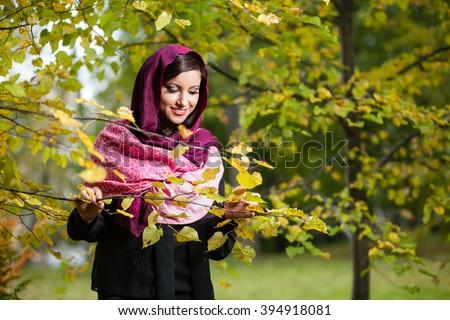 Girl in autumn park. - stock photo