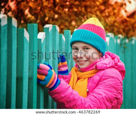 Girl in autumn warm clothing.