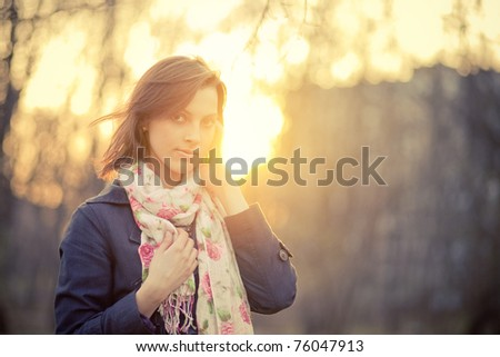 Girl in backlit at sunset - stock photo