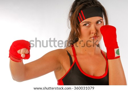 Girl in bandage boxing, boxer rack. Young slim athletic woman is engaged in boxing. Fitness woman with boxing wraps on her hands