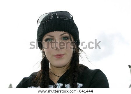 Girl in Beanie looks perplexed - stock photo