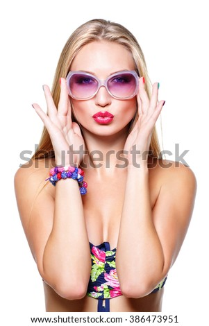 Girl in bikini and sunglasses - stock photo