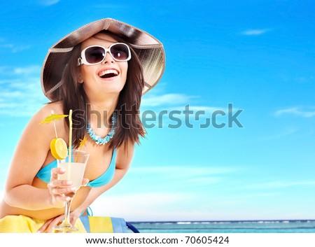 Girl in bikini drink juice through a straw. - stock photo