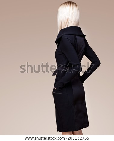 Girl in black. Back view - stock photo