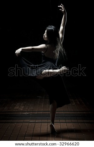 girl in black dancing - stock photo