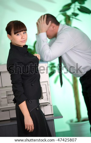 Girl in black jacket and men on green background - stock photo