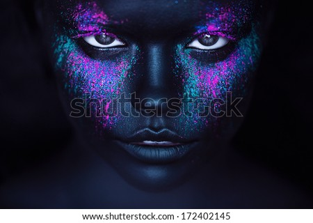 girl in black paint and neon powder - stock photo