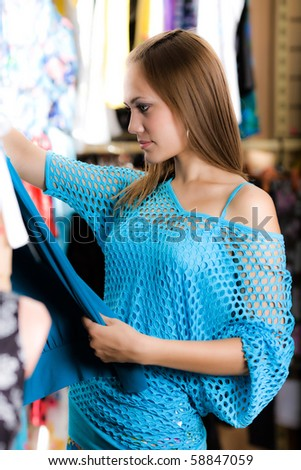 Girl in blue blouse is shopping - stock photo