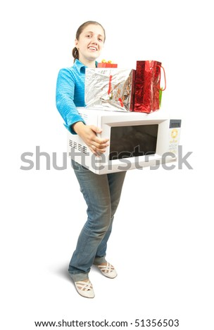 Girl in blue with microwave  and present boxes. Isolated over white - stock photo