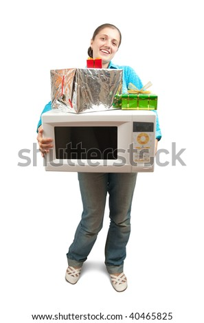 Girl in blue with microwave oven and present boxes. Isolated over white - stock photo
