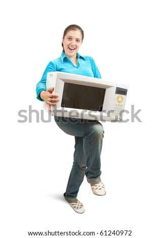 Girl in blue with microwave oven. Isolated over white - stock photo